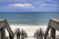 Down to the Beach. Wooden walkway down to the shore, over the sand dunes.  Ocean and horizon on clear day Stock Photos