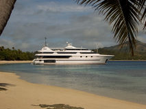Down To The Sea In Ships. A magnificent motor yacht is moored in the tranquil Blue Lagoon in Fiji Stock Photos