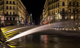 Down town Lyon France by night 2. Down town Lyon France view on the beautiful fountain at night. Long exposure photography Royalty Free Stock Images