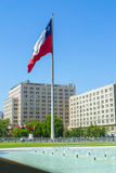 Down town in Santiago Chile. Chile`s biggest flag in an urban scenes, surrounded by water fountains Stock Photography