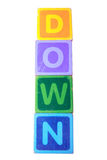 Down in toy play block letters with clipping path Royalty Free Stock Photos