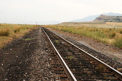 Down the Tracks. Railroad tracks with a mountain in the background Stock Image