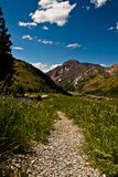 Down the trail. Image of a hiking trail in the mountains of Utah Stock Images
