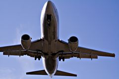 Down Under View. Low flying aircraft approaching airport stock photo