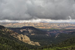Down the Valley to the Red Rock. Looking toward Capital Reef National Park Utah USA from Boulder mountain under stormy sky's with the view of aspens and red rock Royalty Free Stock Photos
