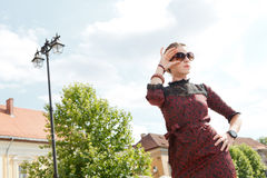 Down view of fashion girl holding glasses. Outdoor Royalty Free Stock Photo