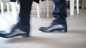Down view on groom walking in room
