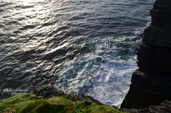 Down View to the Sea from Cliffs of Loop Head Peninsula in Clare, Ireland Stock Images