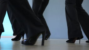 Down view of women dancing in model school. Stepping back and forward, holding feet in air and putting it up young females are studying moving graceful and stock footage