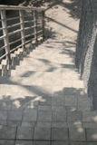 Down way of cement stairs in public park with morning time. Royalty Free Stock Photography