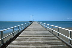 Down the wharf. Looking down the Hervey Bay Wharf royalty free stock photography
