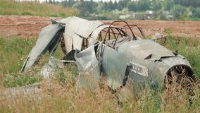 Downed rusty wrecked aircraft on the battlefield after the Second World War.  stock footage