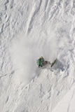 Downfall. Snowboarder downfalling down  the slope Royalty Free Stock Photography