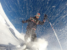 Downhill alpine skiing at high speed on powder snow. Stock Photos