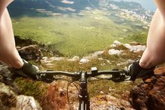 Downhill on a bicycle Royalty Free Stock Photography