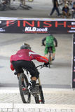 Downhill bicycle racers Stock Images