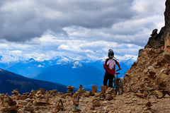 Downhill bike. A guy is about to start his downhill mountain bike ride in the rocky mountains Royalty Free Stock Images