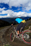 Downhill bike. A biker is going to a downhill ride in the rocky mountains Royalty Free Stock Photography