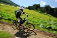 Downhill bike racer Stock Photo