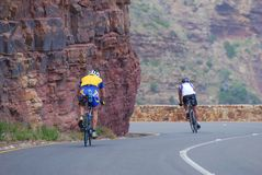 Downhill cyclists. Two cyclists training on Chapman's Peak Drive,Cape Town Stock Photos