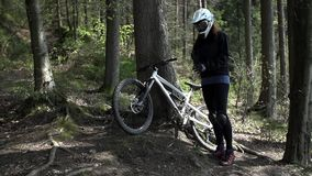 Downhill driver take a bike and start to train stock video