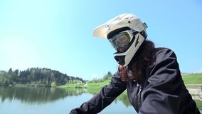 Downhill driver training near the lake. Downhill driver train near the lake in a slow motion close up shot stock video footage
