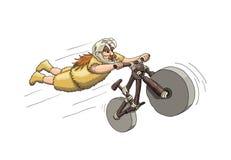 Free Downhill Mountain Biker From Primal Era. Freeriding Making Superman Stunt On Downhill Bike In Sabertooth Skull Helmet Royalty Free Stock Images - 109743909