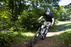 Downhill mountain bikers. In nature Stock Photography