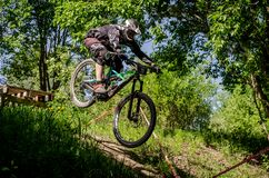 Downhill mountainbike rider. Eduro cup race in finland, mountain bikers racing down the tracks against the clock. Event was Ride More Cup, city Kouvola, Mielakka Royalty Free Stock Photo