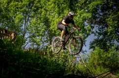 Downhill mountainbike rider. Eduro cup race in finland, mountain bikers racing down the tracks against the clock. Event was Ride More Cup, city Kouvola, Mielakka Royalty Free Stock Image