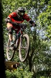 Downhill mountainbike rider. Eduro cup race in finland, mountain bikers racing down the tracks against the clock. Event was Ride More Cup, city Kouvola, Mielakka Stock Image