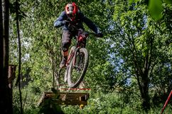 Downhill mountainbike rider. Eduro cup race in finland, mountain bikers racing down the tracks against the clock. Event was Ride More Cup, city Kouvola, Mielakka Royalty Free Stock Photos