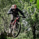 Downhill mountainbike rider. Eduro cup race in finland, mountain bikers racing down the tracks against the clock. Event was Ride More Cup, city Kouvola, Mielakka Stock Photo