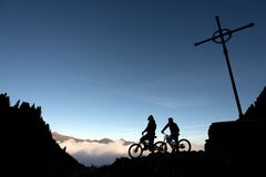 Downhill. People practicing downhill outdoors - silhouette Royalty Free Stock Image