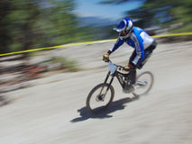 Downhill racer. Mountain bike racer Stock Photo