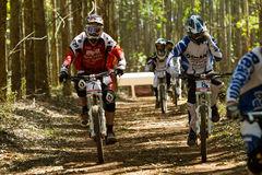 Downhill riders on their way to the start Stock Photo