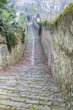 Downhill road in the medieval town Stock Photography