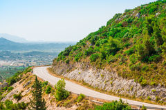 Downhill road through the mountains stock image