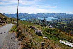 Downhill road sea bay Akaroa Royalty Free Stock Photo