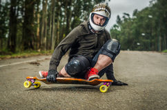 Downhill skateboarder in action Stock Photography