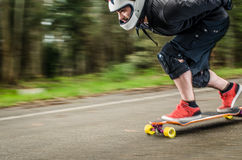 Downhill skateboarder in action Royalty Free Stock Photography