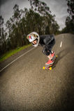 Downhill skateboarder in action Royalty Free Stock Images