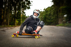 Downhill skateboarder in action Stock Photos