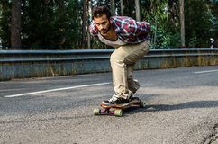 Downhill skateboarder in action Royalty Free Stock Photos