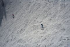 Downhill skier on mountain slope. In sunny winter day Stock Photography