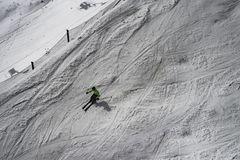 Downhill skier on mountain slope. In sunny winter day Royalty Free Stock Photo