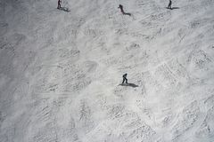 Downhill skier on mountain slope. In sunny winter day Stock Photos