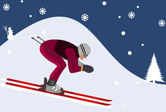 Downhill skier in the mountains Royalty Free Stock Photo