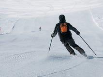Downhill skier. On ski slope, sunny day Royalty Free Stock Photo
