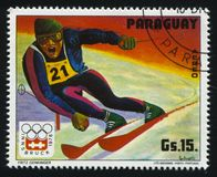 Downhill skier at Winter Olympics in Innsbruck. RUSSIA KALININGRAD, 19 APRIL 2017: stamp printed by Paraguay, shows Downhill skier at Winter Olympics in Stock Photo